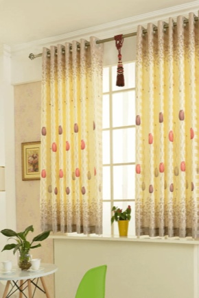 Short curtains to the window sill in the interior of the bedroom