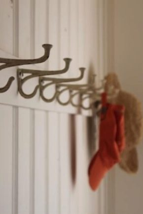 Clothes hooks in the hallway - an important design element