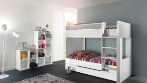 Bunk bed of white color in an interior of the nursery