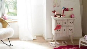 Carpets in the nursery for girls: features of choice