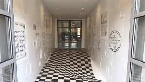 Tile for a corridor: features of the choice and laying