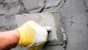 Plastering arbete: subtiliteter av konstruktion