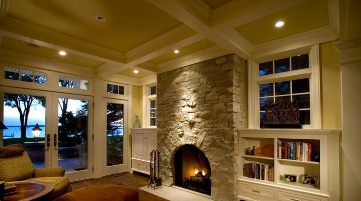 Design a living room with a fireplace in a private house