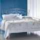 Vita smidda sängar