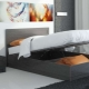 Beds with lifting mechanism