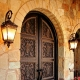 Features forged doors