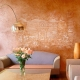 Decorative paint for walls with the effect of sand: interesting options in the interior