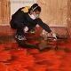 Hur man reparerar det självnivellerande golvet?