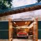 Garage en métal: types de conceptions et caractéristiques d'installation