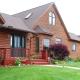 Casa a blocchi con finto legno: caratteristiche e vantaggi