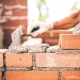 Features of masonry mix for bricks