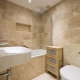 Stone tile for bathroom: features of choice