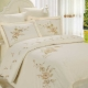 Bed linen with embroidery: variations and advice on choosing
